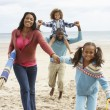 Stock Photo: Happy family running on beach