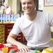 Teacher in nursery school - Stock Photo