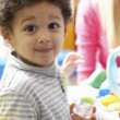 Boy playing with toys in nursery — Stock Photo