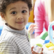 Boy playing with toys in nursery — Stock Photo #11882075