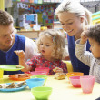 Couple and children playing with toys — Stock Photo