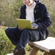 Young man with laptop computer — Stock Photo