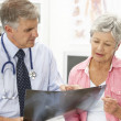 Doctor with female patient — Stock Photo #11882306