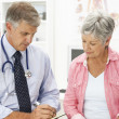 Doctor with female patient — Stock Photo #11882308