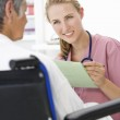 Doctor with female patient — Stock Photo #11882355