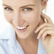 Attractive young woman smiling — Stock Photo #11882398