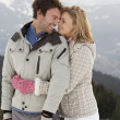 Стоковое фото: Young Couple On Winter Vacation