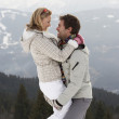 Foto Stock: Young Couple On Winter Vacation