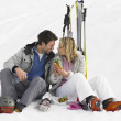 Young Couple With Picnic On Ski Vacation — Stock Photo