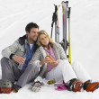 Young Couple With Picnic On Ski Vacation - Stock Photo