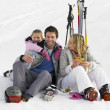 Young Family With Picnic On Ski Vacation — Stock Photo #11882638