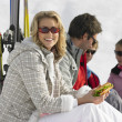 Royalty-Free Stock Photo: Young Family Sharing A Picnic On Ski Vacation