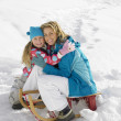 Young Mother And Daughter With A Sled In The Snow — Foto de Stock