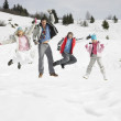 Young Family On Winter Vacation — Stock fotografie