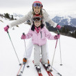 Young Mother And Daughter On Ski Vacation - Stock Photo
