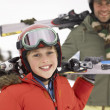 Pre-teen Boy With Father On Ski Vacation — Stock Photo