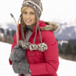 Young Woman holding Skis In Alpine Landscape — Stock Photo