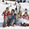 Stock Photo: Young Family Sharing Picnic On Ski Vacation