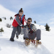 Young Father And Son Sledding — Stock Photo