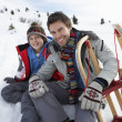 Young Father And Son In Snow With Sled - Stock Photo