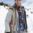 Young Man Carrying Sled In Alpine Landscape — Stock Photo