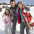 Stock Photo: Young Father And Children In Snow With Sled