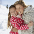 Young Mother And Daughter On Winter Vacation - Stock Photo