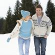 Young Couple In Alpine Snow Scene — Stock Photo #11882755