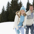 Young Couple In Alpine Snow Scene - Foto de Stock
