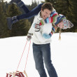 Young Father And Daughter In Snow With Sled — Stock Photo