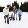 Young Family In Alpine Snow Scene With Sled — Stock Photo