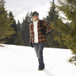 Young Man In Alpine Snow Scene - Stock Photo