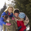 Young Family  In Alpine Snow Scene — Stock Photo