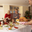 Family having Christmas dinner — Stockfoto