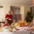Family having Christmas dinner — Stok fotoğraf