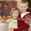 Young family at Christmas dinner table — Stock Photo #11882844