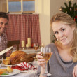 图库照片: Young couple having Christmas dinner