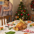 Foto Stock: Young couple at home at Christmas