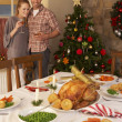 Young couple at home at Christmas - Stock Photo