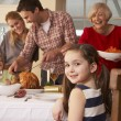 Stockfoto: Family serving Christmas dinner