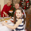 Child having Christmas dinner with grandparents — Stock Photo