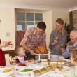 Family serving Christmas dinner — Stock Photo