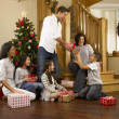 Hispanic family exchanging gifts at Christmas — Stock Photo #11882860