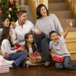 Hispanic family taking photos at Christmas — Stock Photo