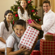 Hispanic family exchanging gifts at Christmas — Stock Photo #11882865
