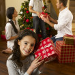 Hispanic family exchanging gifts at Christmas — Stock Photo