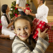 Hispanic family exchanging gifts at Christmas — Stock Photo #11882870