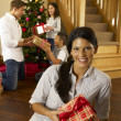 Hispanic family exchanging gifts at Christmas — Stock Photo #11882871