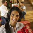 Hispanic family exchanging gifts at Christmas — Stock Photo #11882872