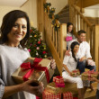 Hispanic family exchanging gifts at Christmas — Stock Photo